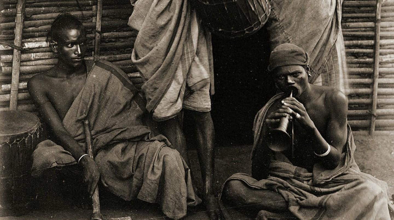 An 1871 image showing Irula men in a village in Tamil Nadu