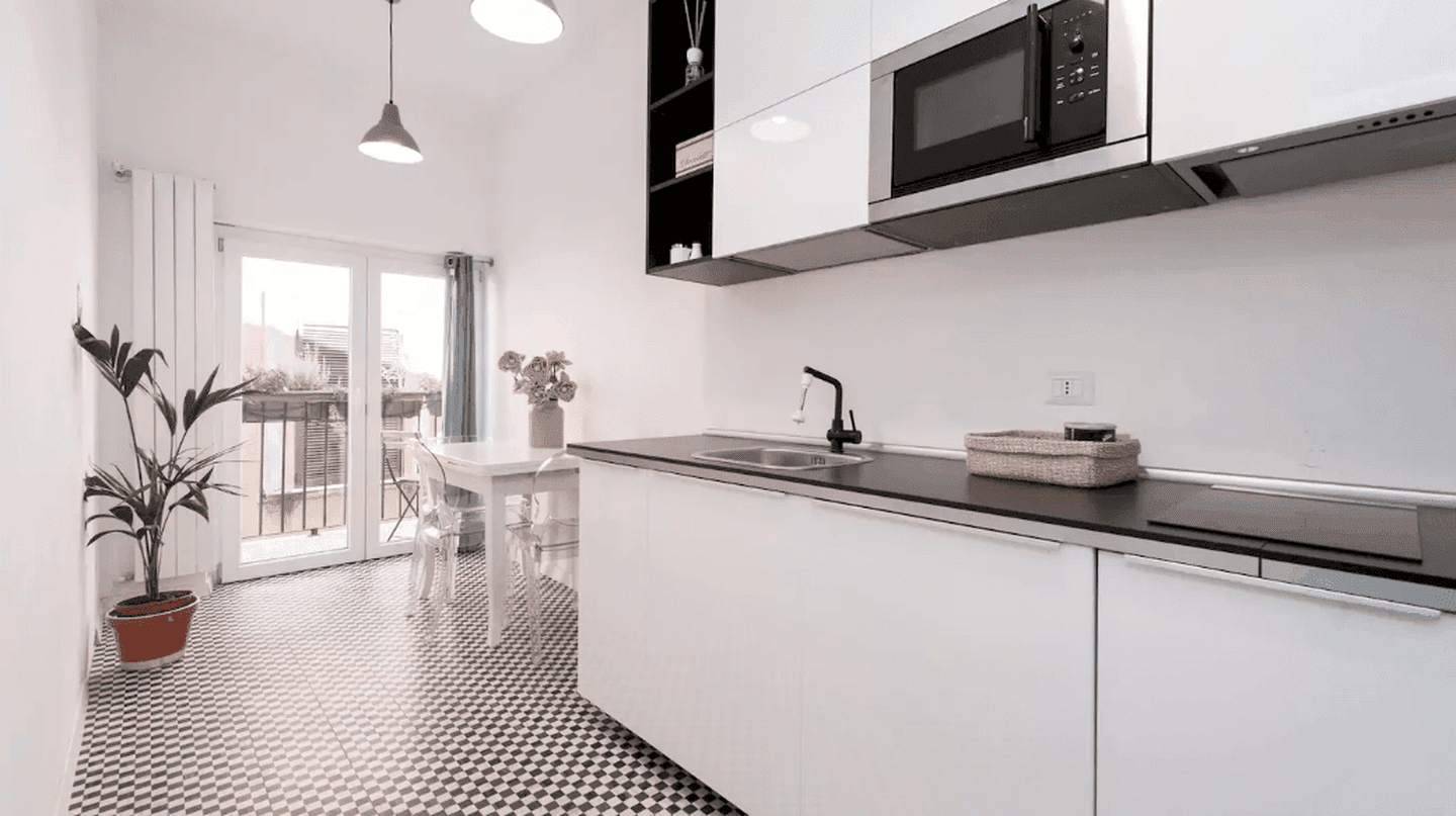 The sleek kitchen of this loft apartment in Pigneto