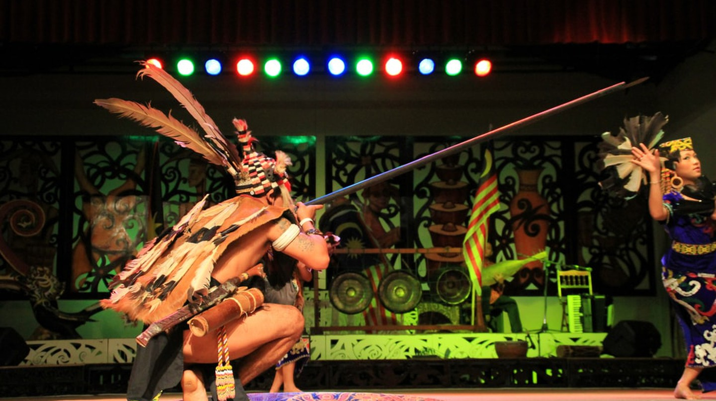 Iban warrior with a blowpipe during the music festival in Sarawak