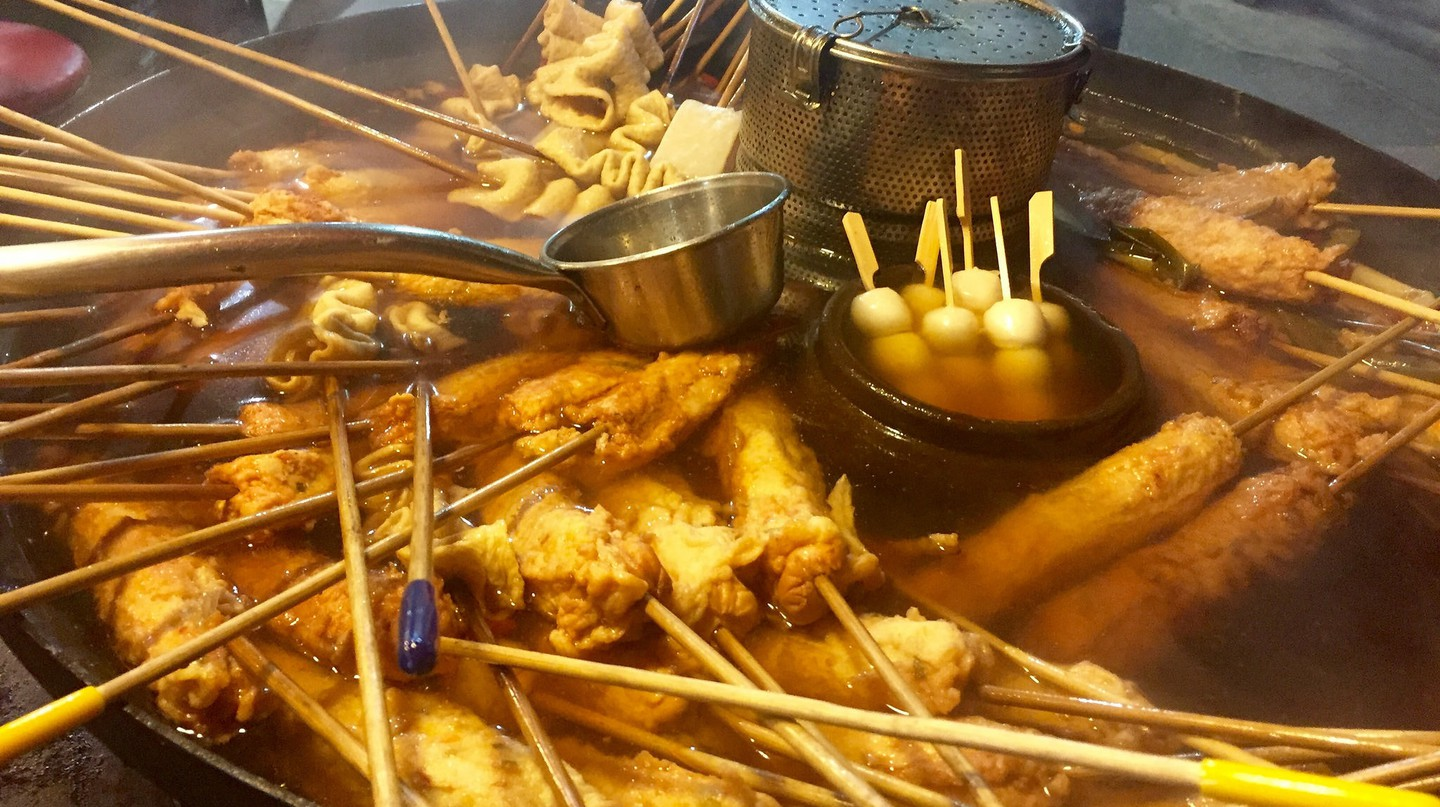 Fish cakes sold as the street food staple odeng — fish cakes concertinaed onto skewers and cooked in a warm broth.