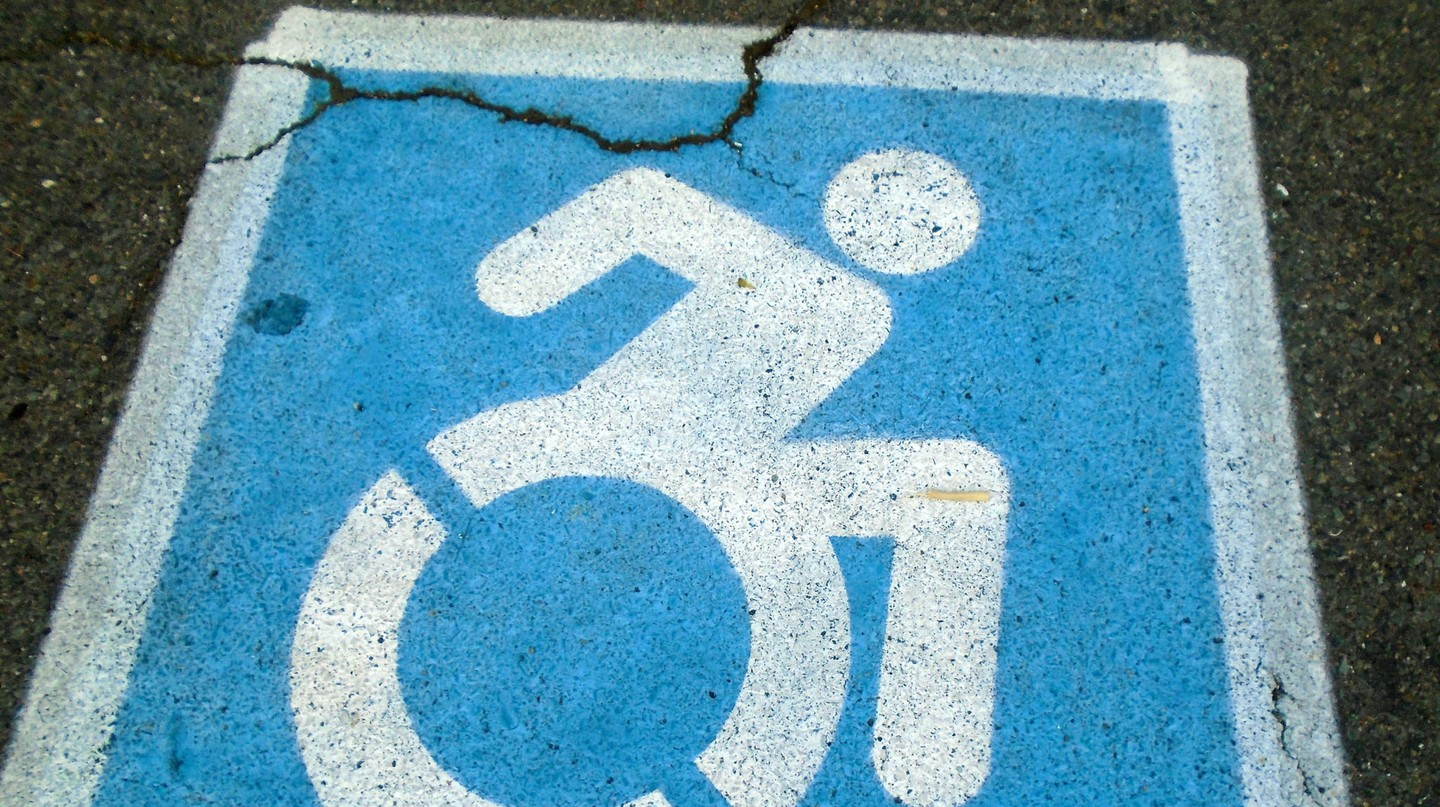 The new symbol features a person leaning forward