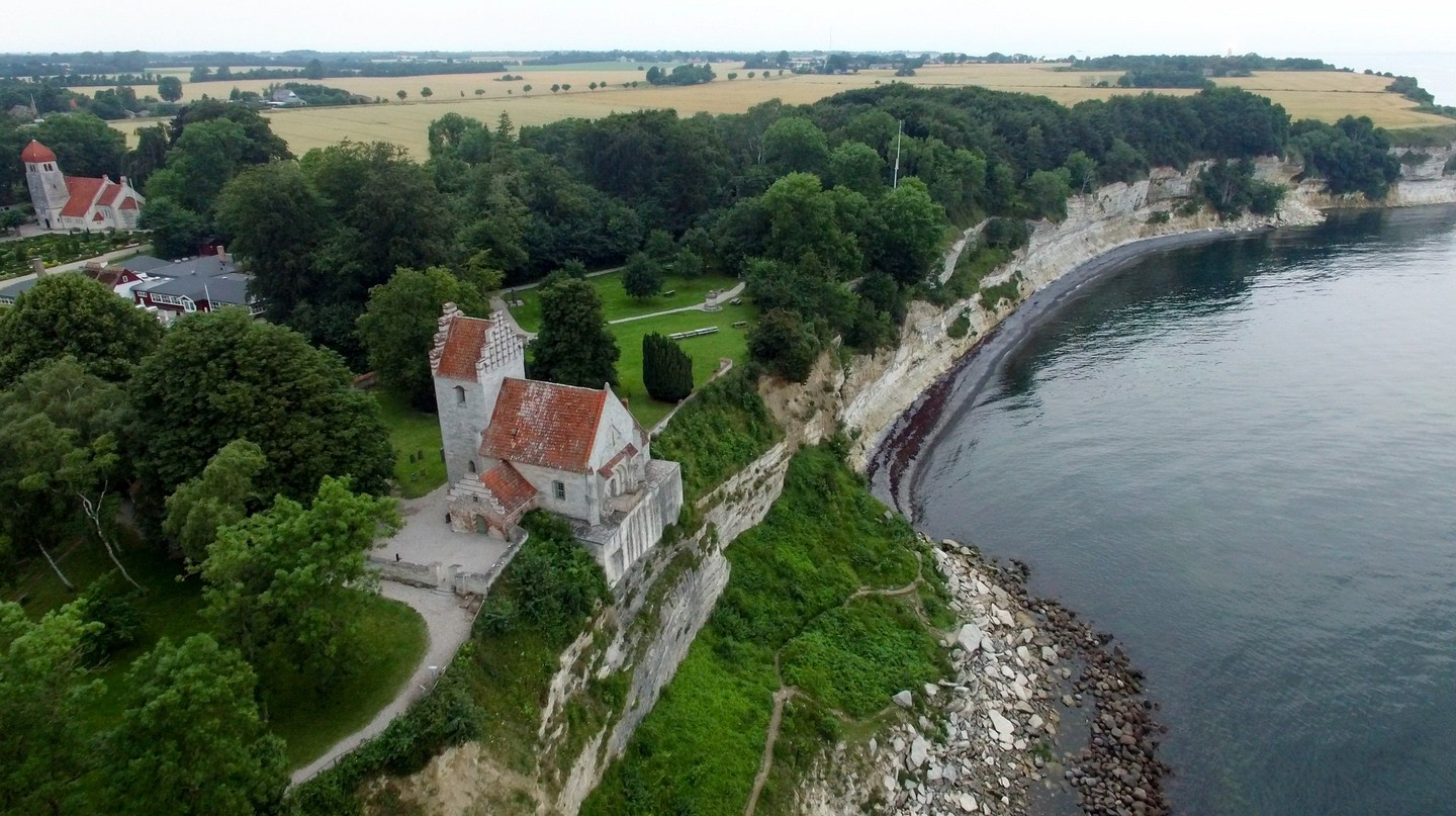 Stevns Klint and the historic Højerup Gamle Kirke from above