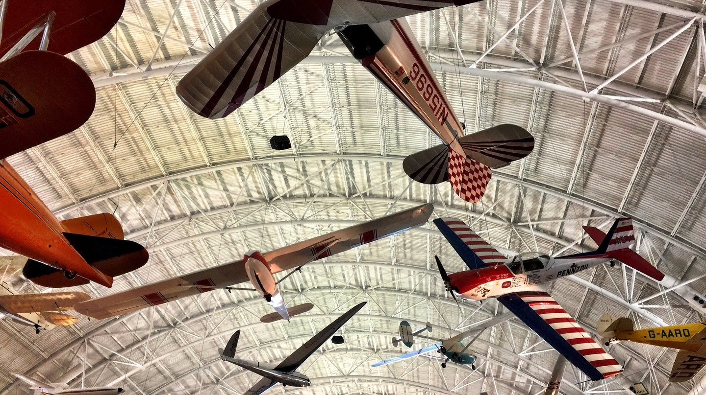 Old planes hang at the hangar of the Udvar-Hazy Center of Smithsonian's Air and Space Museum
