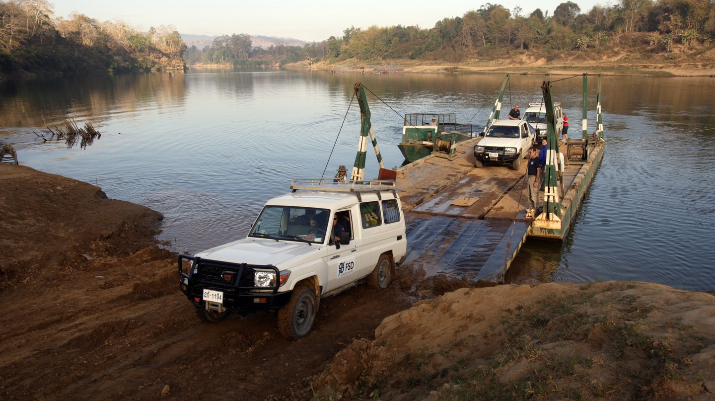 Vehicles cross the Sekong River