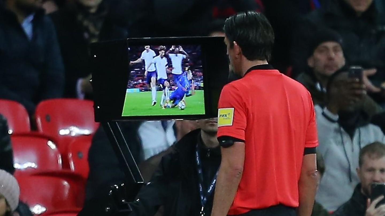 Referee Deniz Aytekin consults VAR before awarding a penalty to Italy