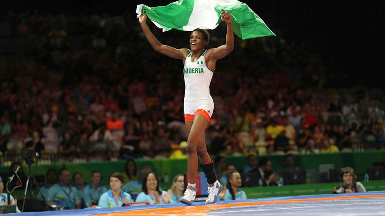 Odunayo Adekuoroye celebrates winning gold at the 2018 Commonwealth Games