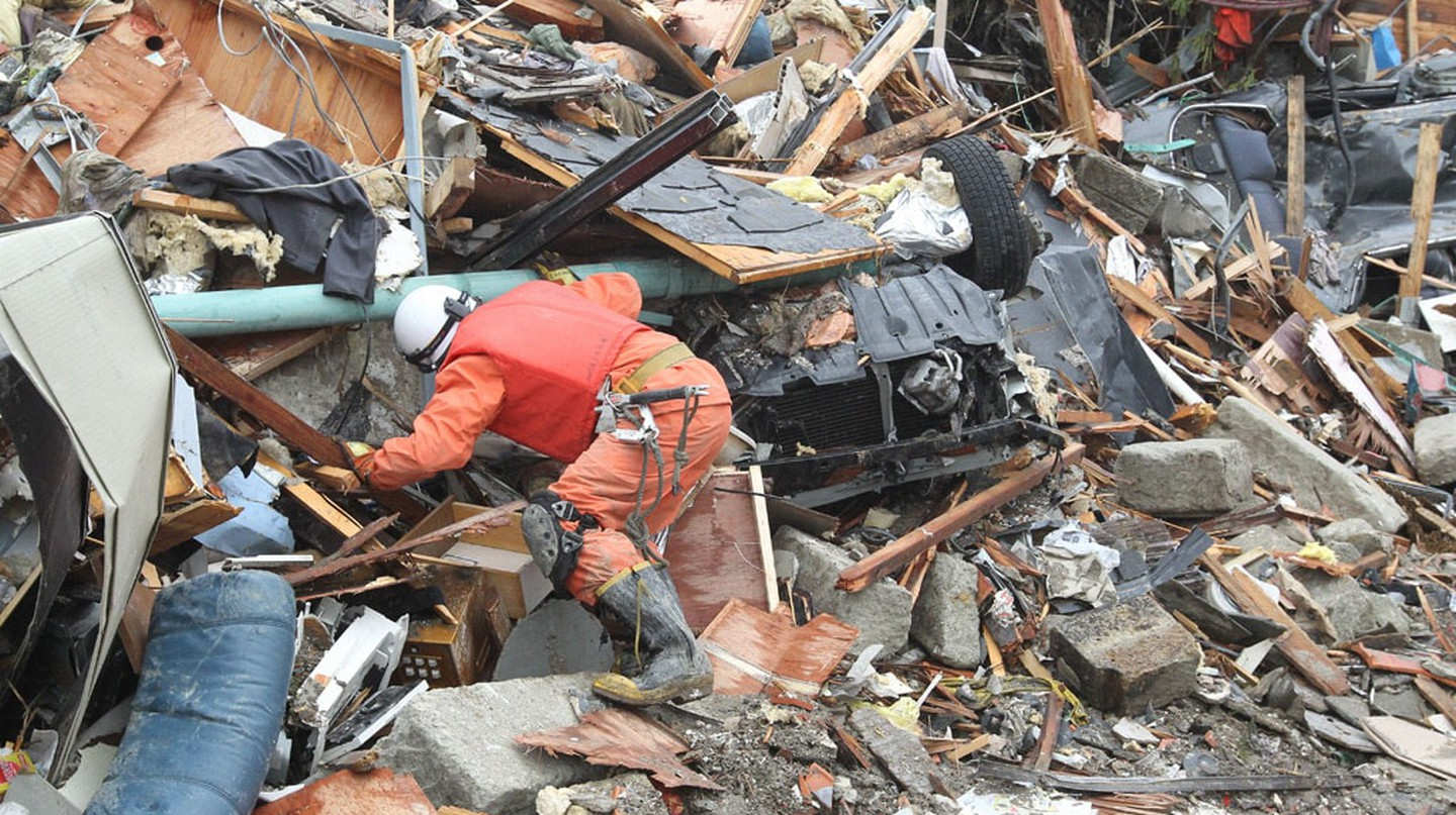 Rescue teams searching for missing people in Natori devastated by the 2011 quake.