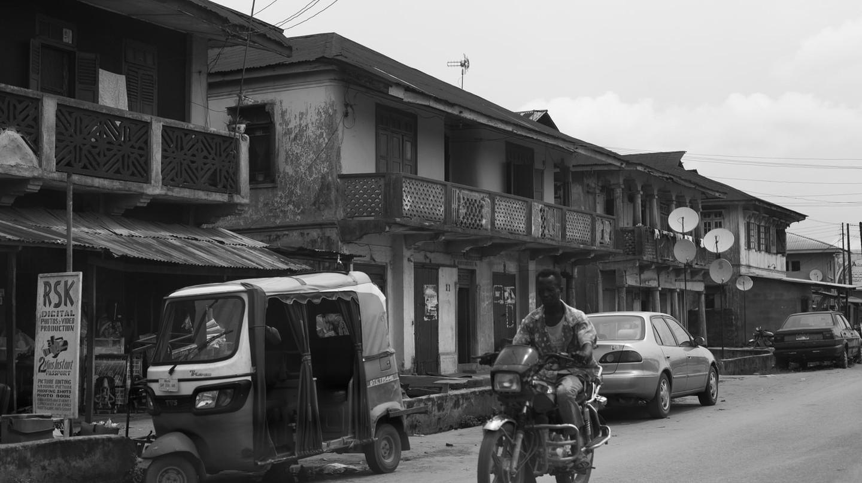 A man riding a motor bike in Sapele, Nigeria