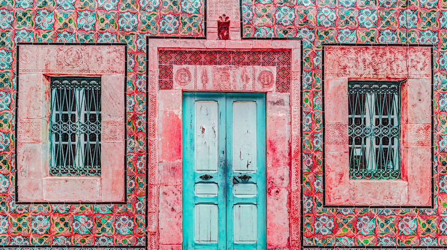 Traditional old painted door in a historical district or medina, Tunisia