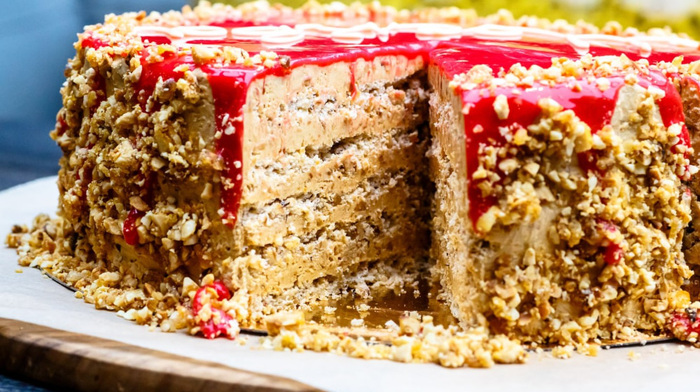 The official cake of Moscow, consisting of multiple layers of walnuts and sponge topped with red glaze