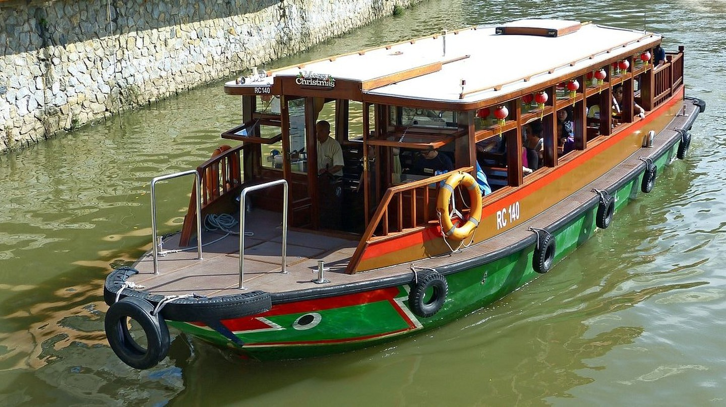 A bumboat takes a trip down Singapore River