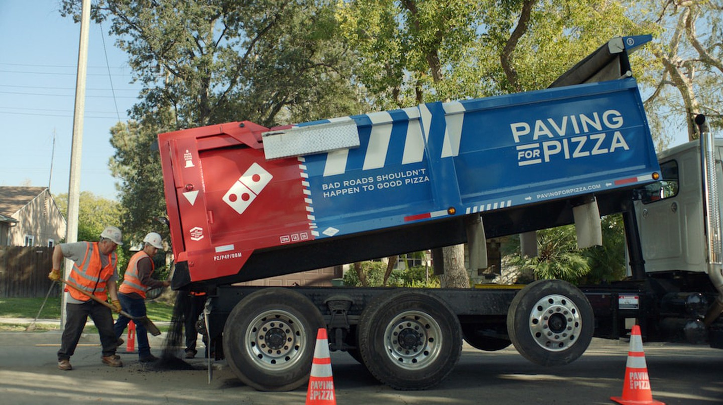 Domino's is fixing potholes and cracked roads in cities across the country