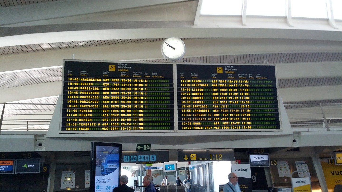 A departures board at Bilbao airport, Spain