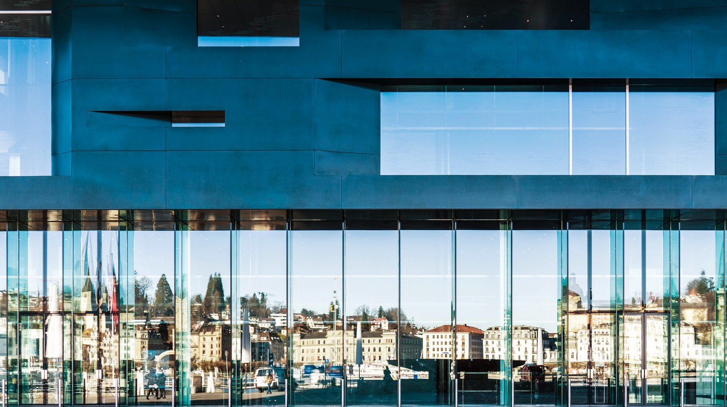 Lucerne skyline reflected in the window of the Culture and convention centre Lucerne (KKL Luzern)