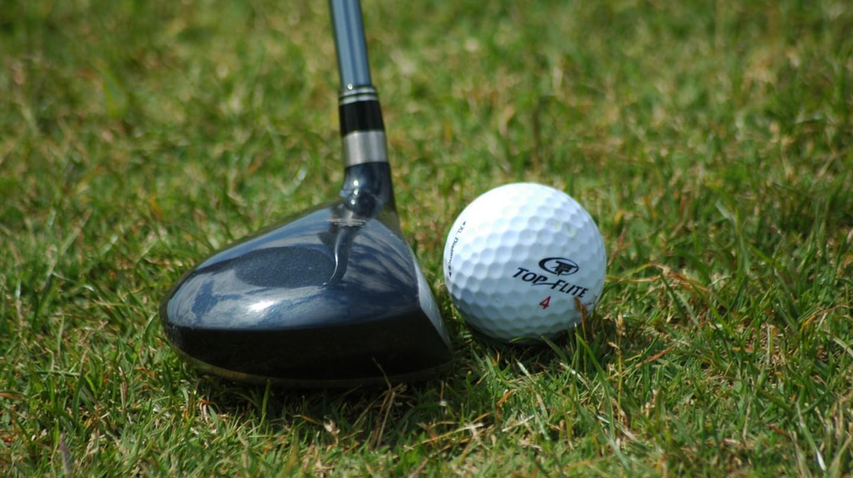 A golf club and golf ball