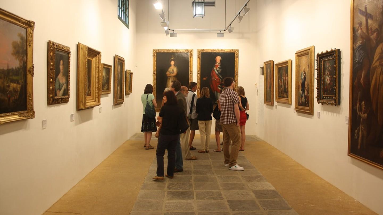 Visitors admire paintings at the Bodegas Tradición in Jerez de la Frontera, Spain