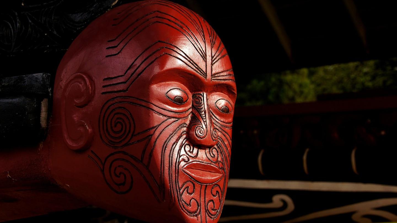 A carved wooden figurehead from a Māori war canoe