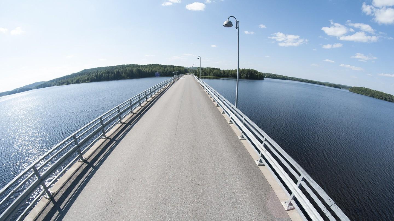 A remote road crosses a lake in Finland