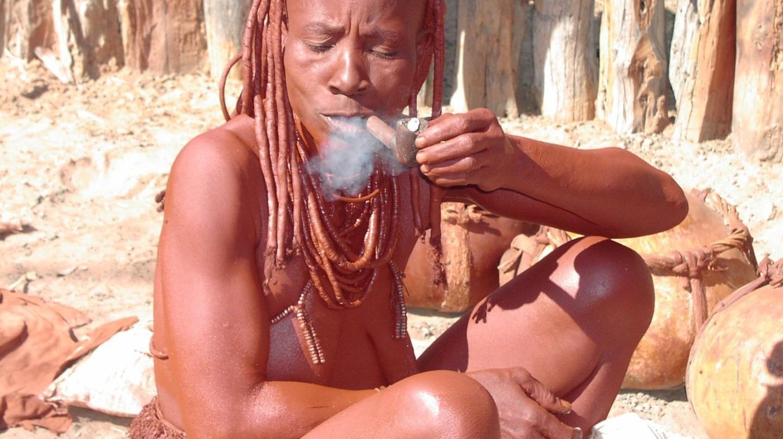 A Himba woman enjoying a smoke