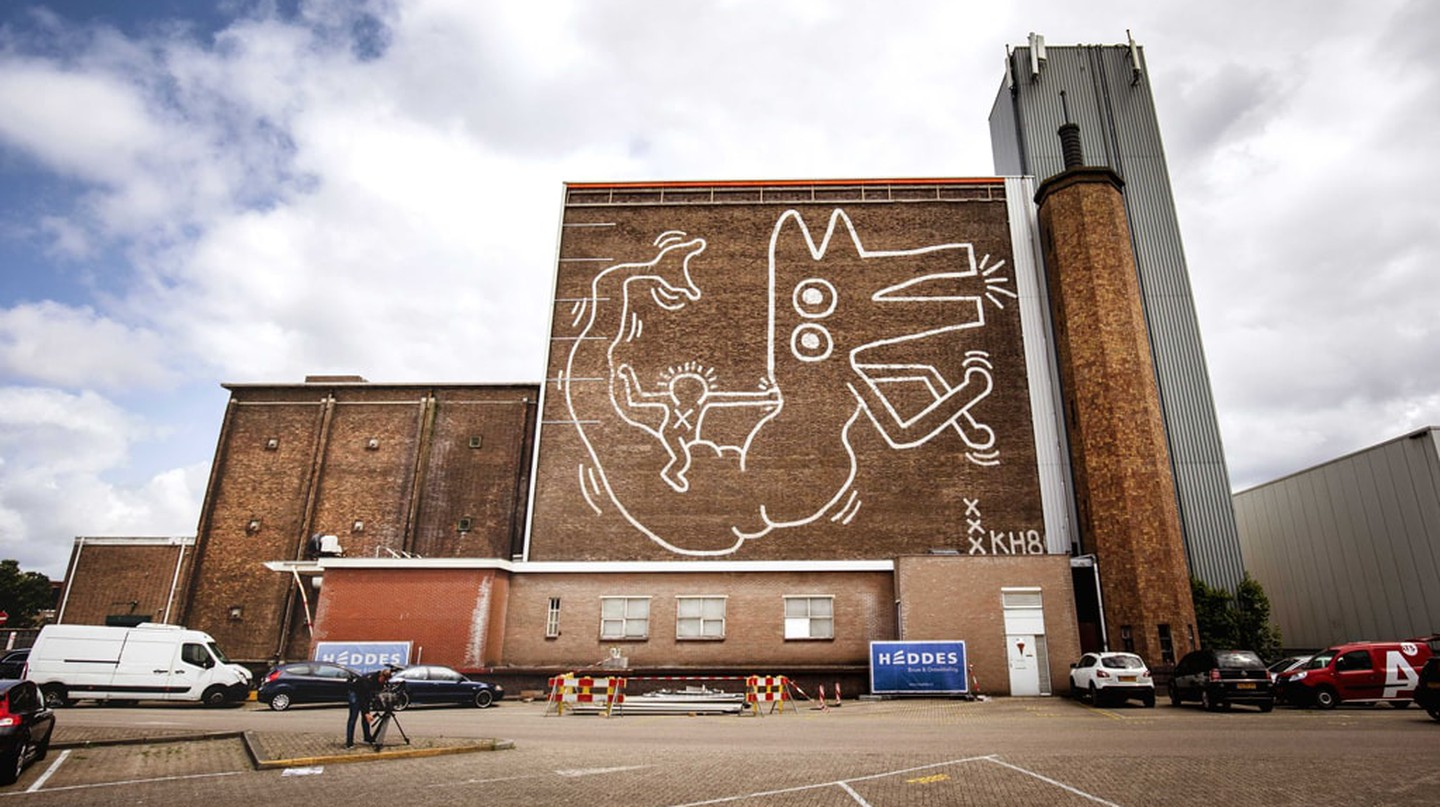 Mandatory Credit: Photo by REMKO DE WAAL/EPA-EFE/REX/Shutterstock (9724796a) A view of the enormous mural painted by the US artist Keith Haring in 1986 on the wall of the former depot of the Stedelijk Museum Amsterdam, in Amsterdam, The Netherlands, 22 June 2018. The mural was then only visible for a few years and disappeared behind aluminum sheets that were removed after almost 30 years. Keith Haring mural made visible in Amsterdam, Netherlands - 22 Jun 2018