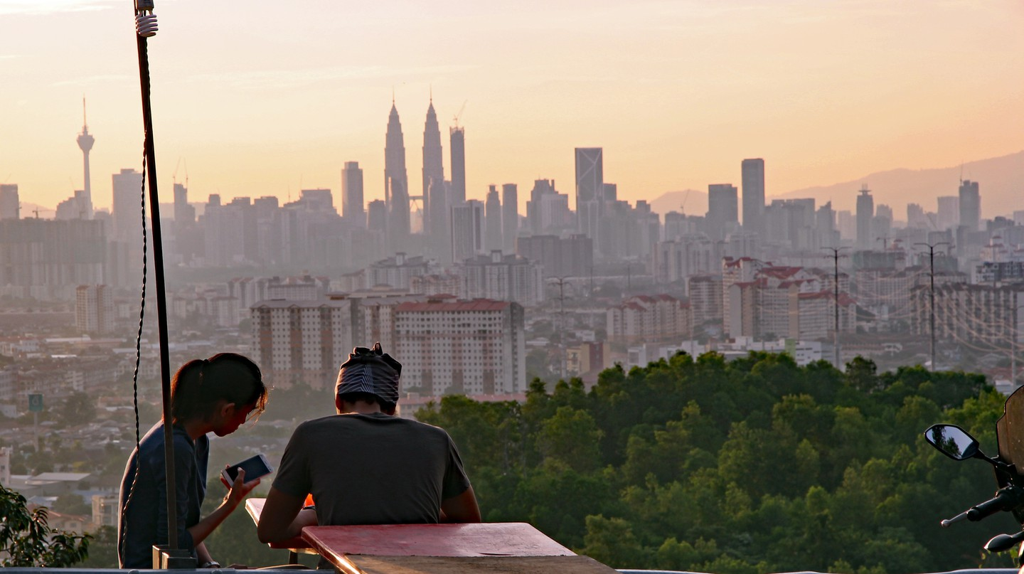 Young couple enjoying the view of Kuala Lumpur's skyline