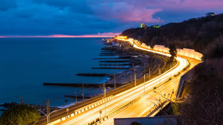 View of the sea and Kurortny Prospekt with light trails, Sochi, Russia
