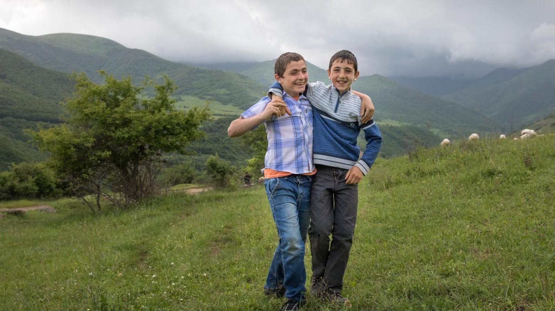 Armenian boys in a countryside