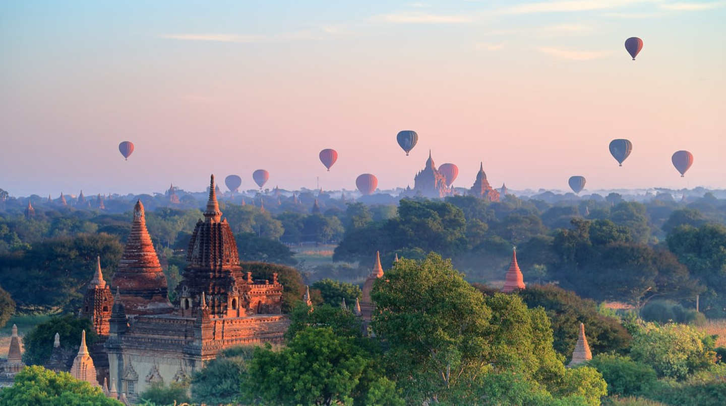 Hot air balloons over pagodas in sunrise at Bagan, Myanmar