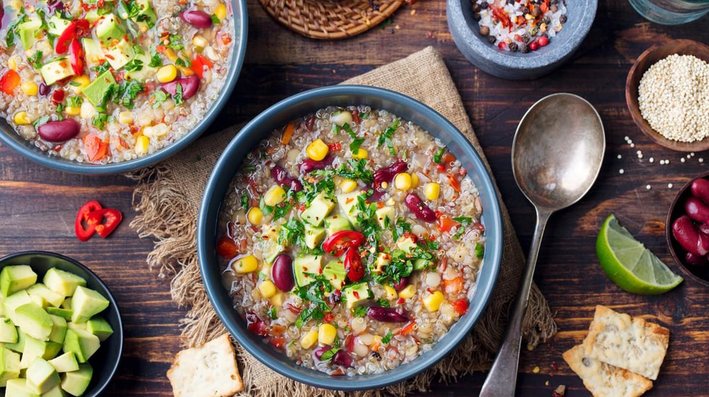 Vegetable quinoa soup, stew with avocado, corn, beans