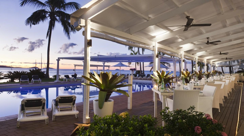 Poolside dining at Coral Sea Resort