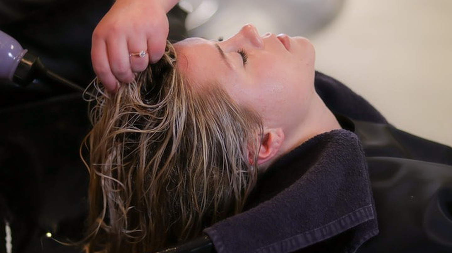 A woman getting a relaxing hair treatment