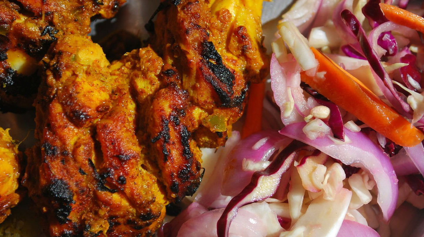 Savour delicious street food like chicken kebabs in Old Delhi