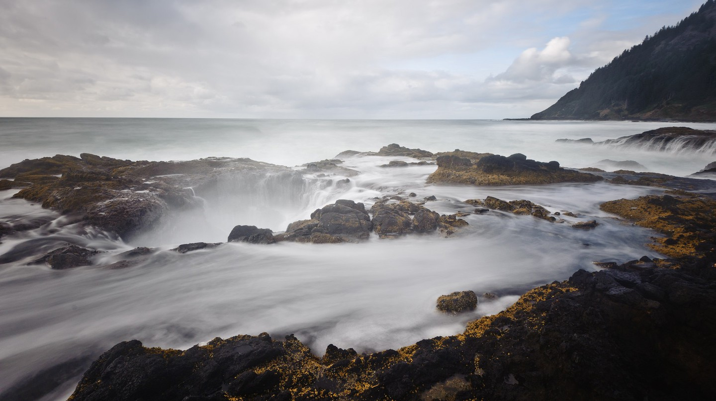 Thor's Well is one of the natural wonders you might see when taking a coastal hike in the Pacific Northwest