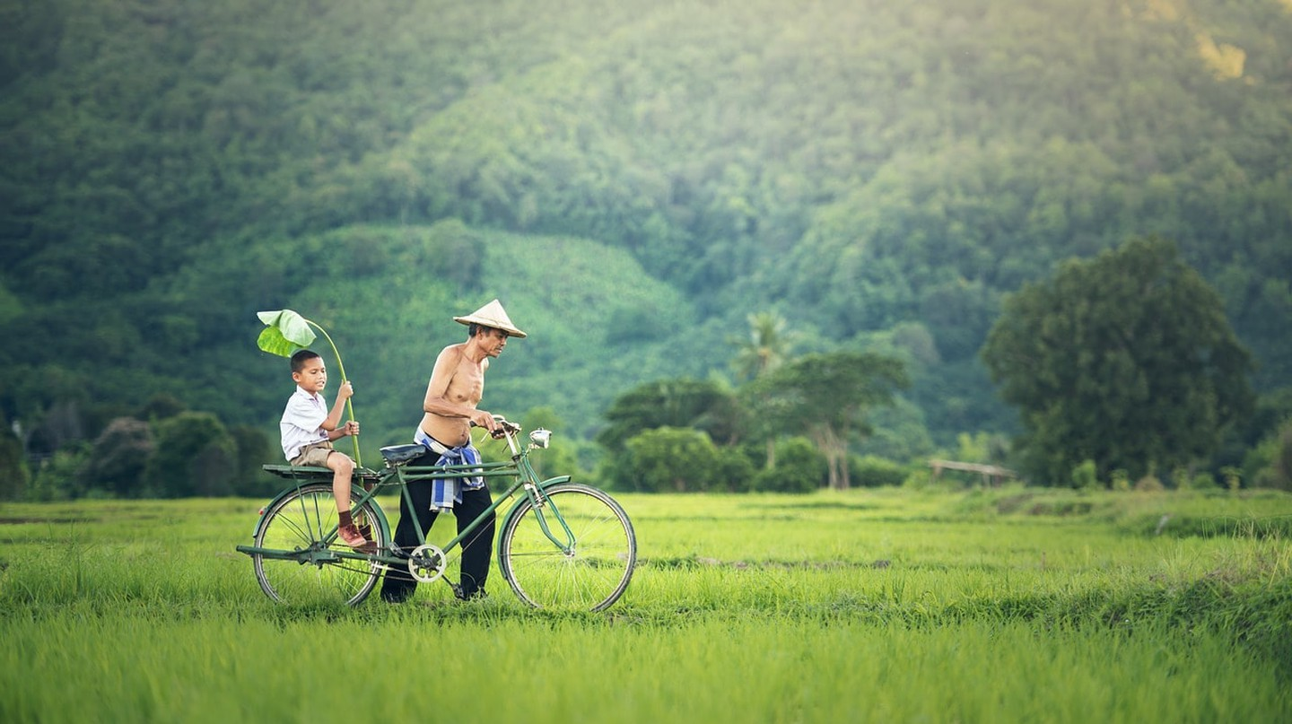 A man and boy with a bicycle