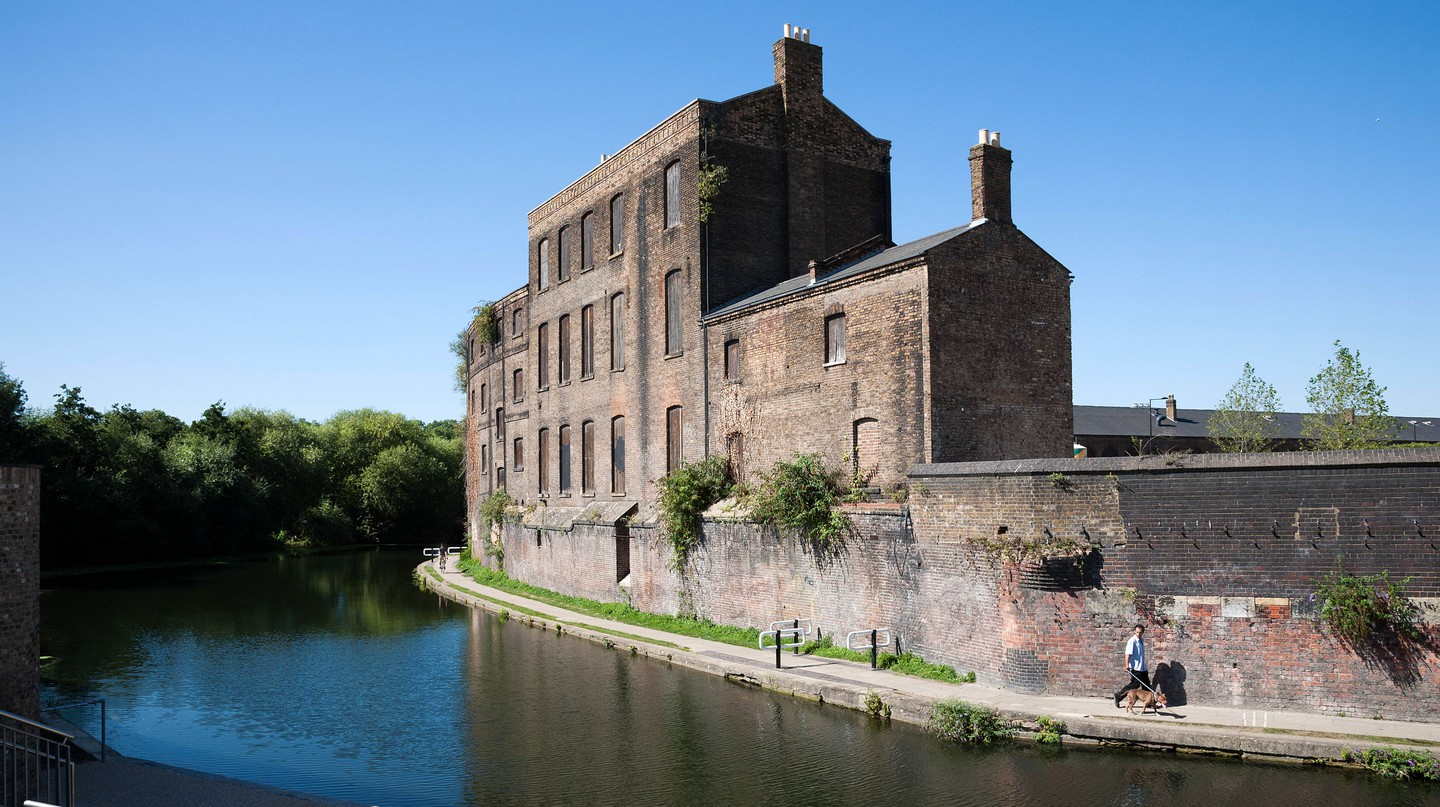 Victorian wharf building on Regents canal in London Kings Cross