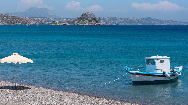 Beach at Kamari Bay showing Kastri Island, Kos