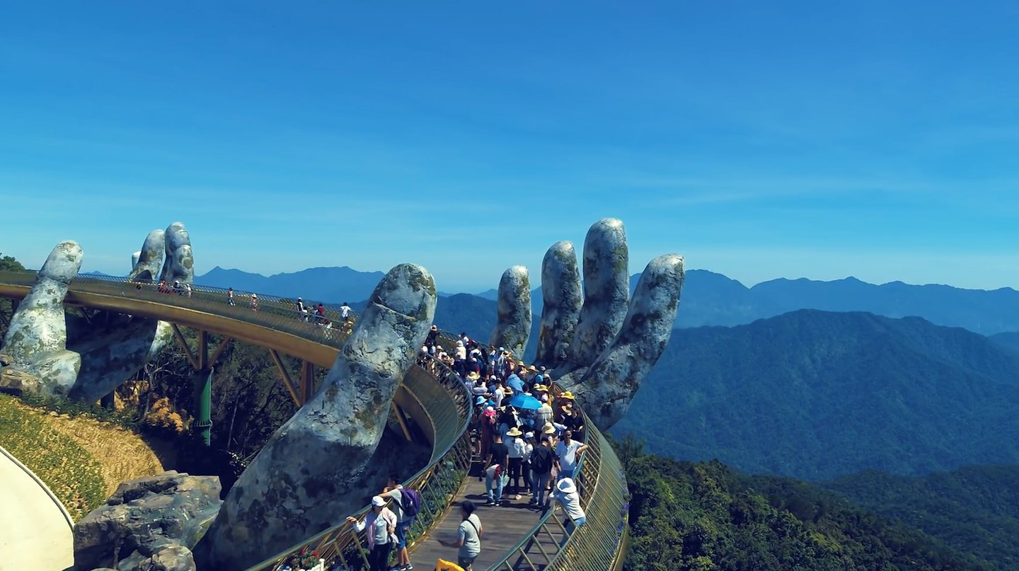 Giant Stone Hands Hold Up This Golden Bridge in Vietnam