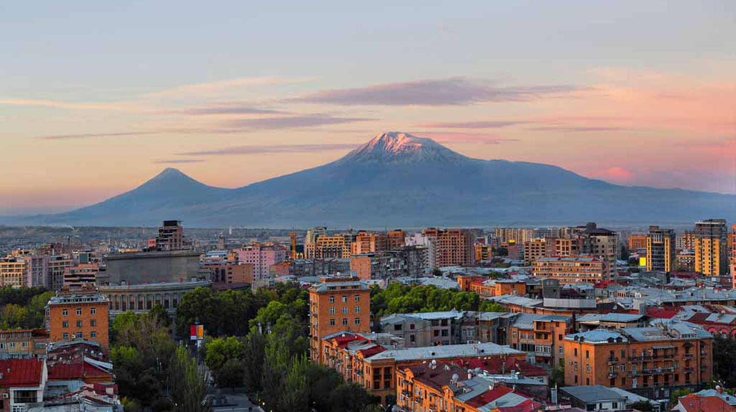 Yerevan at the sunrise with the two peaks of the Mt Ararat in the background, Armenia.