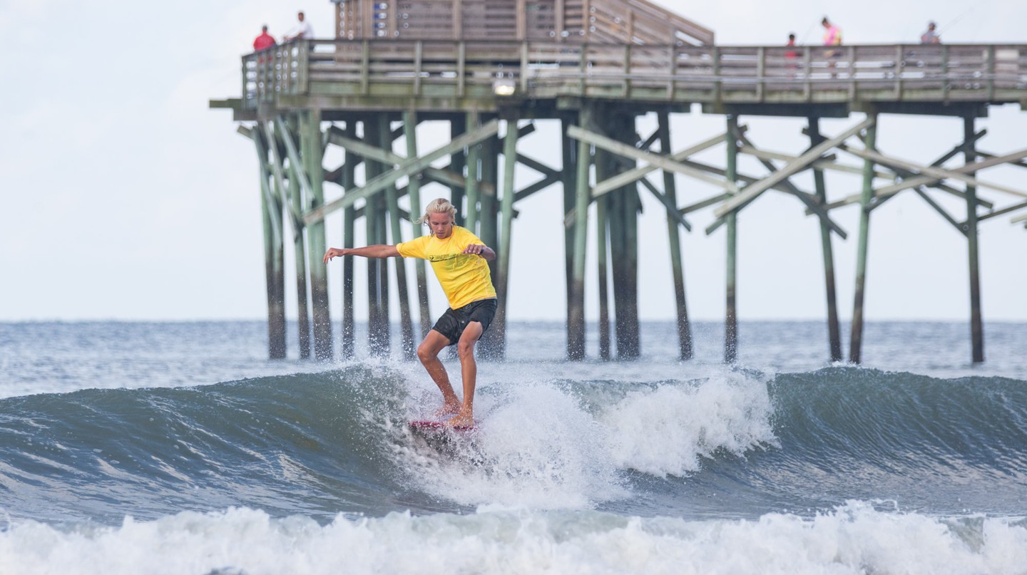 Surfing adjacent to many of the area's piers is common among locals