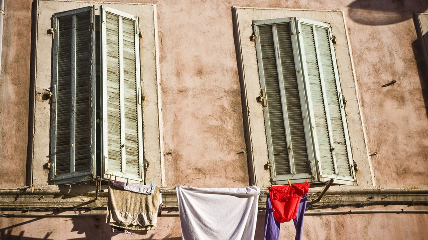 Washing line outside building in Marseille, France.