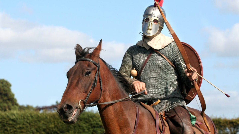 A historical reenactor on horseback