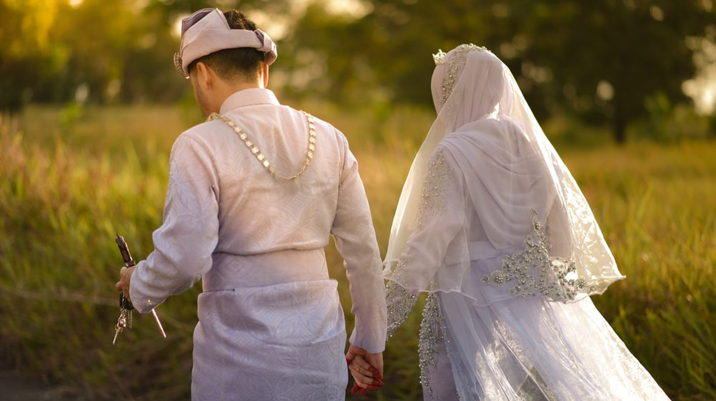 A Malay couple holding hands