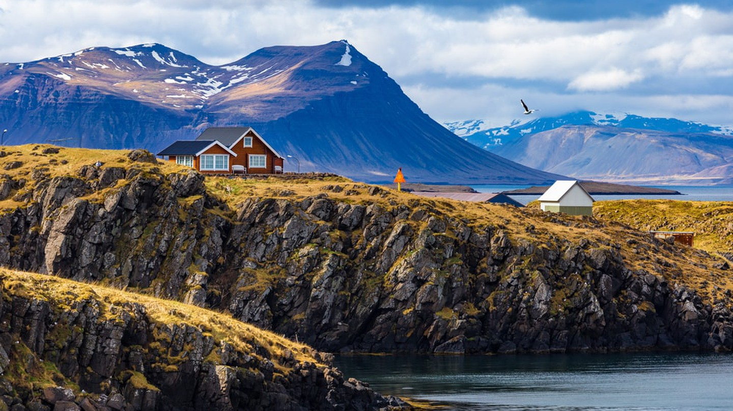 Houses against mountains in village of Stykkisholmur, Western Iceland