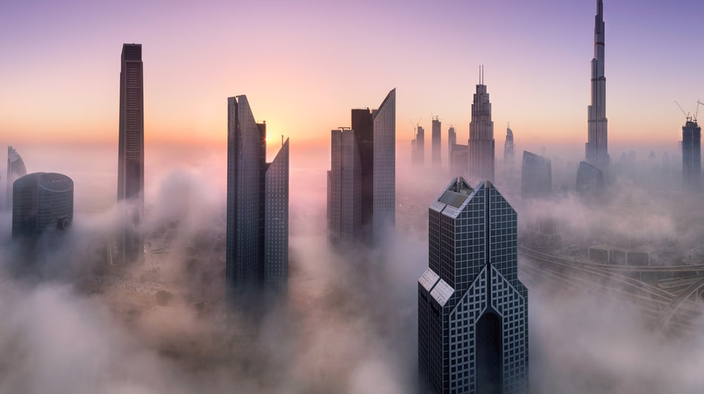 Dubai skyscrapers surrounded by the fog