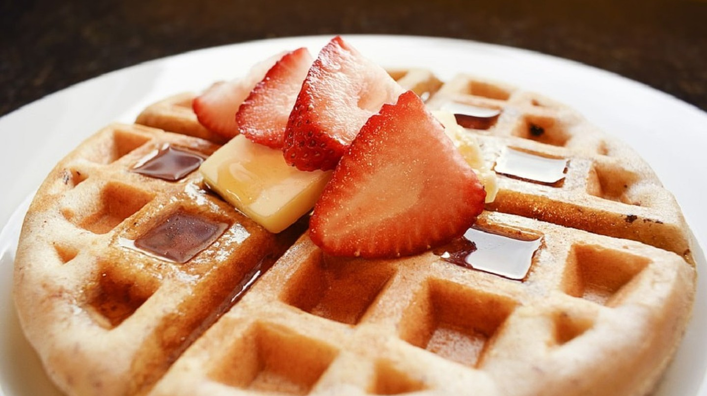Waffle with chocolate sauce and strawberry