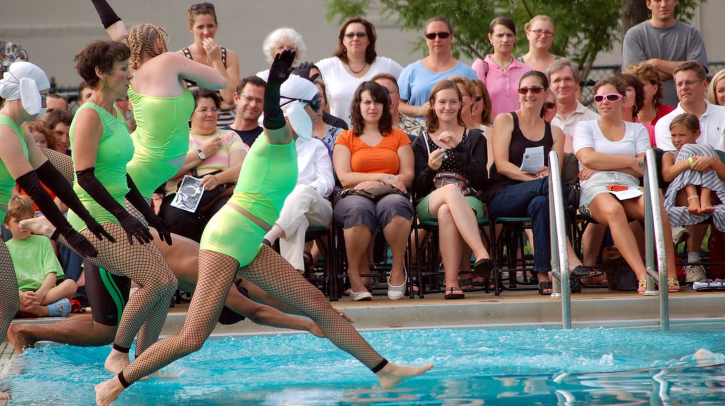 Fluid Movement's synchronized swimmers jump in for their routine.