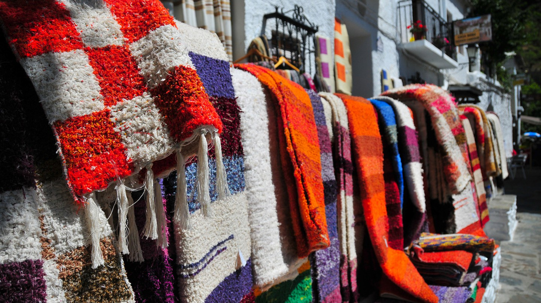 Handwoven rugs on sale in Pampaneira, Sierra Nevada