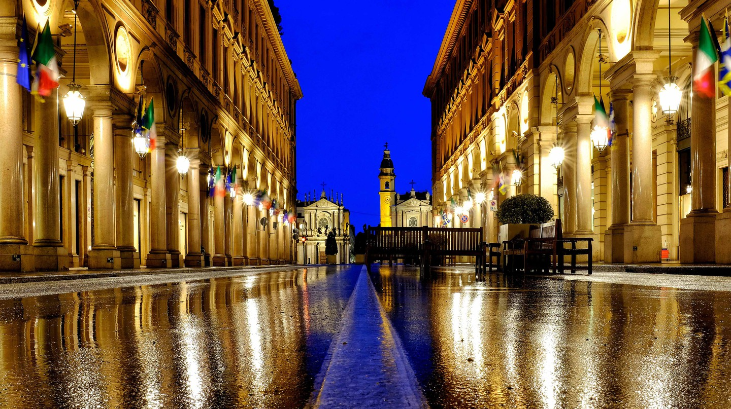 Turin's famous Via Roma in the rain