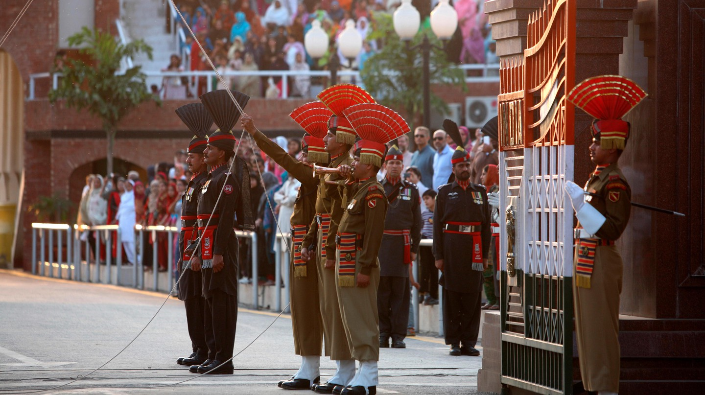 Indian Border Security Force soldiers and their Pakistani counterparts in a parade