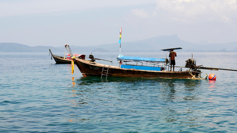 Longtail Boats at Poda Island, Railay beach, Thailand.